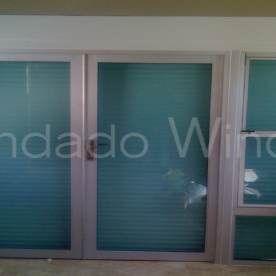 Combo Door Shutters and Double Hung Windows